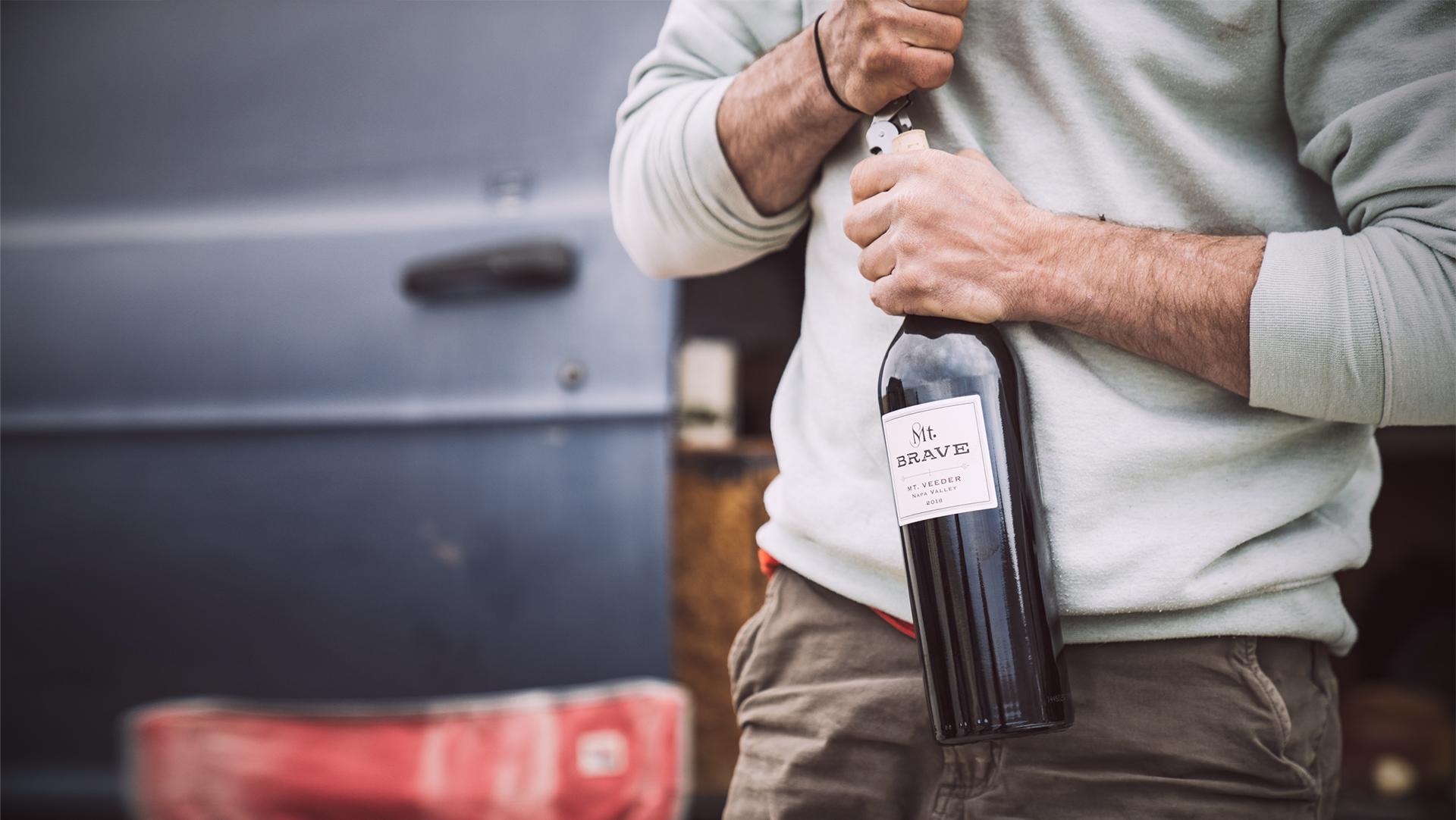 Man holding wine bottle
